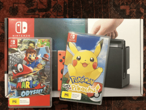 Birthday, Nintendo, and Mild: NINTEND O  NINTENDO  SWITCH  NINTENDO  SWITCH  X  Y  Pekemey  Pkachug  SUPER  MAR  ODYSSEY  CITY  Let's  GO  PG  Mild themes and  violence, online  interactivity  Mild violence  online interactivity  PG Just unwrapped a super early birthday present (21st November). I've wanted one since the release!