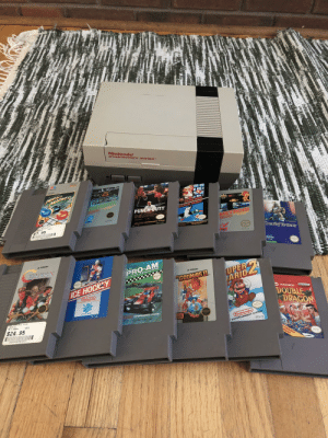 One heck of a graduation present! The NES has all of its pins too!: Nintendo  ENTERTAINMENT SYSTEM  MB  MARBLE  MADNE  TIM 209 MPH DCORS  044 G G12000  MARIO BROS  SUPER  Nintendo NTERTAINAET  PUNCH-OUT!!  DUCK HUNT  Fhr Tr T  D 5A CR  GAME S PLUS  aHadnes SED  anes  METROID  7. 95  Plintendo ENTERTAINMENT SYSTEM  NES-PT-USA  Nintendo N TAINNSNT  Tende EnT YSTEM  032244048807  RTAINMENT  DeadlTosders  bnd  ADVCT  NES MT USA  vstarSories  KONAMI  R.C  PRO-AM  UPER  ARIO  KONAM  32 Tracks of Racing Thrills  GOONIESI  SHE  ICE HOCKEY  Nintendo  BTERTAINMENT SYSTET  TRADEWEST  Nintendo  DOUBLE  DRAGON  SPORTS SERIES  NES HY-USA  ES PLUS  Contra  NES Games  fintendo ENTERTAINMENT SYSTEM  USED  $24. 95  PM-USA  O 1987 Rare, Ltd  Nintendo  000008943207  ENTERTAINMENT SYSTEM  e  NES-W ms  ARCADE  MASH! One heck of a graduation present! The NES has all of its pins too!