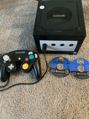 I just got a GameCube for Christmas! I'm pretty excited to start playing some games on it.: NINTENDO  GAMEC UBE  NINTENDO  GAMECUBE  SONIC  BAVRLE  SALL ALA  SONIC  HEROES  ADVENTUREL  SEG  EVERYONE  NINTENDO  istode  GAMECUBE.  NINTENGO  GAMECUBE.  ESRB  See  FOR USE ONLY IN USA CANAGA MEXICO ANG LATIN AMERICA  DL-DOL-GSNE-USA  AOR USI ON V N USI CANAUA MEAICO ANE ATM AMEHIL  MODEL No. DOL-006USA  OL-DOL-GSSE-USA  MODEL NO DOL-006U5L I just got a GameCube for Christmas! I'm pretty excited to start playing some games on it.