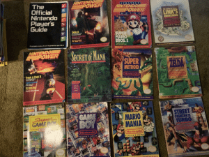 Check out what I found at my parent's house.: NINTENDO  POWER  The  Official  Nintendo  Player's  Guide  STRATEGY  NINTENDO  EPOWER  THE LEGEND OF ZELDA:  LINK'S  AWAKENING  G UT DE  Nintendo  ATIR'S GUI  Zelda I  The Adventure of Link  Bleckbuster Review  SUPER  MARIO  BROS.3.  Nintendo Power Bowl  Thres Game Kickofl  Offal  Skate ar Die Feature  Plus Mondo Pester  isterade)  Seatof  Castand ntento, Part 2  Acomplete revieur of over 90games for your N.E.S.  84 pages of maps,  tactics and power plays!  Clintendo  THE SOURCE FOR NES PLAYERS STRAIGHT FROM THE pr  Mtendal  Your lisk to sorelving the Nightmares af Koholiat-frem he  Nintend PLAYTO-WN STRATEGIES STRAIGHT FROM THE PROS  NINTENDO  POWER  SECRET Of MANA  eert  SUPER  METROID  0FFICIA  GAME SECRETS  THE LEGEND OF  ZEIDA  AUFR TO THE PAST  Track&Field II  Nintendo  ETAIOINE Event  Tear He Ihe Thack  NintenO  PLAYER'S GUIDE  Cantain Nintend  Vidng Super tHere  Fielien Fealure  PLAYER S GUIDE  RUSSEL DEMARIA  Mure Biastor Mastn  Ts and Hs  Dretly brn  Sparet  Bigantie Moliday Olveaway  THe NE  SewnMisd  he vomplete PMayer's Colde to Super Metroll-streigt hrem the pres at Nintende  Nintemb THE BOURCE POR N AYERS STRAIGHT FROM 1P  Tear link to the uliimate  endensture streight trom the pres et Niatendel  ANARO  Opus  STREET  FIGHTERII  TURBO  GAME  BOY  Super  GAME BOY  MARIO  MANIA  Ninten  Nintendo  Nintendo  ER'S  PLAYER'S GUIDE  PIAYER'S GUIDE  MARIONAND  omcia  Cold  (Gamonido  Nintendo  Seal of Quality  heet igh  froe Niutendo  юа зт  ME BOY GAME BOY  GAME BOY  AME BO  BOY GAME BOY  GAME BOY  GAME BO  GA  GAME BOY  GAME BOY  GAME  GAME BOY  GAME OY Check out what I found at my parent's house.