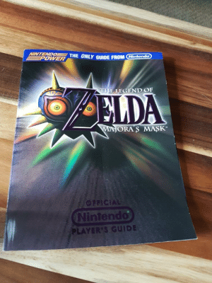 Was doing some storage cleaning today and found this relic from my childhood.: NINTENDO THE ONLY GIDE FROM Nintendo  EPOWER  THE LEGEND OF  ELDA  MAJORA S MASK-  OFFICIAL  Nintendo  PLAYER'S GUIDE Was doing some storage cleaning today and found this relic from my childhood.