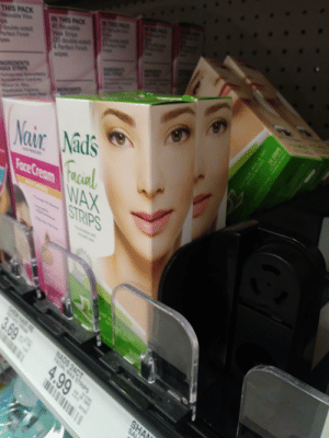They couldn't find another way to print this face?: NN AD  IN TMIS PACK  40 Reusa  Wa St  Q0 dubi  4 P  wiges  THIS PACK  Reusotle Wa  u  uble e  F  (  NREDNTS  NAX 5TRP  NONOS  Nair Nads  FRsal  cia  Fare Cream WAX  STRIPS  AAR RE  3.69  NADS 24CT  FACIAL WAX STRIPS  4.99  SHA  SA  e l They couldn't find another way to print this face?