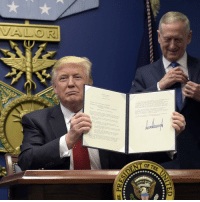 President DonaldTrump with Defense Secretary James Mattis, shows his signature on an executive action on rebuilding the military during an event at the Pentagon. (AP Photo-Susan Walsh): nn  of THE  **★★★부  ★訳訳长부  **$X-부 President DonaldTrump with Defense Secretary James Mattis, shows his signature on an executive action on rebuilding the military during an event at the Pentagon. (AP Photo-Susan Walsh)