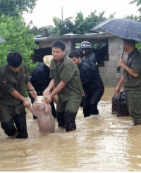 Kim Jong-Un, Soldiers, and Korean: North Korean soldiers escort Kim Jong-un to safety through flood waters. (2009)