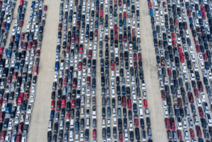 Not a salvage lot: people waiting in their cars for aid from the San Antonio Food Bank on April 9.: Not a salvage lot: people waiting in their cars for aid from the San Antonio Food Bank on April 9.