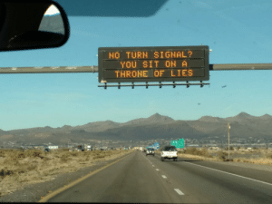 Arizona, Today, and Sign In: ,  NOTURN SIGNAL?  YOu SIT ON A  THRONE OF LIES This message sign in Arizona today