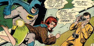 Batman dishes out bat-justice!: NOW-- HERE'S  HOO-BOY!...  WHAT A  PICTURE!  SOMETHING YOU  SHOULD HAVE  HAD A LONG  TIME AGO--!  EEK!  PUT ME DOWN,  YOU CAPED  IDIOT... YOU  COSTUMED  CREEP.. YOU--  OWWW! Batman dishes out bat-justice!