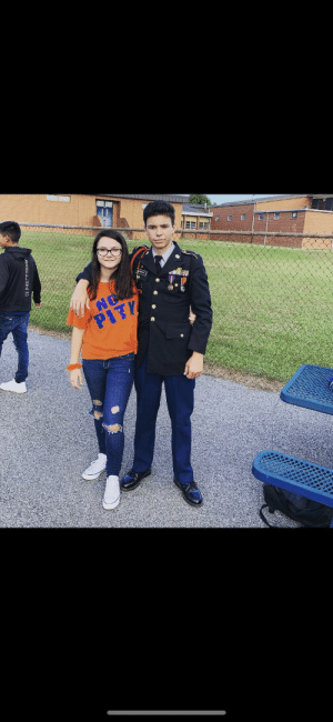 Me and my second favorite sister, out at a school football game. My first time doing a color guard march to start the game. #cromedome: NOW  PITY Me and my second favorite sister, out at a school football game. My first time doing a color guard march to start the game. #cromedome