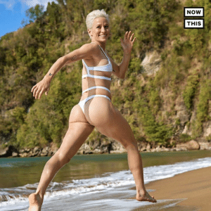 (W) Meet the first openly gay woman to pose for Sports Illustrated Swimsuit Issue: Megan Rapinoe: NOW  THIS (W) Meet the first openly gay woman to pose for Sports Illustrated Swimsuit Issue: Megan Rapinoe