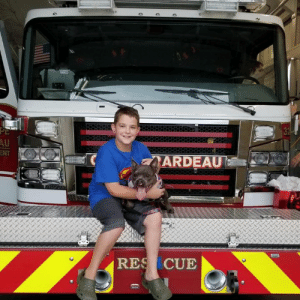 My sissy Quigley is splitting her time while mom is gone with aunt Keely and aunt Natalie's families because she is difficult and has to eat specially. So Eli had the special privilege to take her to visit the Cape Girardeau Firefighters! How epic is that?! I may let them keep her as a hot mess mascot!!! BOL!   Love, MacJustJokingBigBro: NT  ARDEAU  RES CUE My sissy Quigley is splitting her time while mom is gone with aunt Keely and aunt Natalie's families because she is difficult and has to eat specially. So Eli had the special privilege to take her to visit the Cape Girardeau Firefighters! How epic is that?! I may let them keep her as a hot mess mascot!!! BOL!   Love, MacJustJokingBigBro