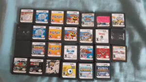 I found a load of ds games while cleaning out a storage room! (Yes that is 3 mario party cartridges): NTEND DS.  sNTENDDS  HITENDDS.  INTENDODS.  TECDS.  PACMA  AUR  ScooRy  Doo  goit  ATTACK  CINTERCS9  AteREN  TR-TLIS-USA  NTR-TADE-USA  HTR-APME-USA  KTR-ARTE-USA  TR-559-95A  STR-COLE-USA  HINTEND DS.  MINTENDODS.  HINTENDO  FAINTENO DS,  NINTENDO  White  AROPANTY  SONIC  SEGA ALL-STARS  AttACK  RACING  UBISOFT  NTR-TADE-USA  NTR-ABTE-USA  STR-APWE-USA  NTR-CUSE-USA  STR-CS3E-USA  HINTEND DS.  NINTENDO  DS.  IRITENO DS.  PHINTENODS.  PAINTEHODS  NINTENDODS.  SONIC  MOPALTY  SONIC  CLASSIC COLLECTION  MARGO KART.  ACTIVEION,  KAR  VBBS  NTR-ABTE-USA  TWL-VSOE-USA  dby  dadty  NTR-ACZE-USA  NTR-ASCE-USA  NTR-BWOE-USA  TEND DS.  NTENDODS.  PNINTENDODS.  STAR  LUCO  DS.  NINTENDO  HINTEND DS.  OK  WARS  SONIC  THE LEGENDARY  CHRONICLES  THE DARK BROTHERIOOD  BIOWARE GA  ESELA  STARFY  STA-ABUE-USA  STR-YLGE-USA  EOHO  NTR-TWSE-USA  NTR-BSOE-USA  NTR-YSSE-USA  77  0: I found a load of ds games while cleaning out a storage room! (Yes that is 3 mario party cartridges)