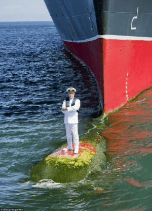 Captain Kevin Oprey stands on the ship's bulbous bow, which protrudes from the front of the 151,200 ton liner, to pose for a portrait with his ship.The photograph was taken to mark the 10th anniversary of the liner in May this year at a port off the coast of Bali.: O James D. Morgan REX Captain Kevin Oprey stands on the ship's bulbous bow, which protrudes from the front of the 151,200 ton liner, to pose for a portrait with his ship.The photograph was taken to mark the 10th anniversary of the liner in May this year at a port off the coast of Bali.