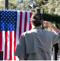 A Gulf War veteran salutes in tribute to former President George H.W. Bush at the makeshift memorial formed outside the 41st president's home in Houston, Texas, Saturday.: oarm A Gulf War veteran salutes in tribute to former President George H.W. Bush at the makeshift memorial formed outside the 41st president's home in Houston, Texas, Saturday.
