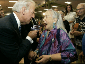 Joe Biden forcing a woman to vote by making her an offer she can't refuse (2008): OBAMA Joe Biden forcing a woman to vote by making her an offer she can't refuse (2008)