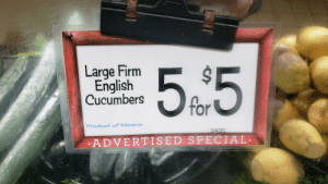 Oddly specific produce advertising. Large firm English cucumber anyone?: Oddly specific produce advertising. Large firm English cucumber anyone?