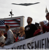 A B-2 Stealth Bomber made a fly-over during the singing of the national anthem by the US Army chorus before kickoff of the Rose Bowl NCAA college football game.: OECS  AP Photo/Mark J. Terrill A B-2 Stealth Bomber made a fly-over during the singing of the national anthem by the US Army chorus before kickoff of the Rose Bowl NCAA college football game.