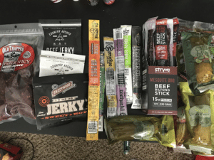 On G: OERS  stryve  wve  NO HITRITES/RITRATES  MESQUITE  COUNTRY ARCHER  BARB  EQUE  NAN  OUNTRY  RCHER  FREESTON  Jerky Co  166  110  2  Western's  OLDTRAPPER  Ze  ERKY  W  cy  су ‑  15  GRAMS  PROTEIN  Chile  ime  ZERO SUGAR  MOKED  FOOD FOR DOERS. MADE BY DOERS  SUPERIOR  TASTE  PICK  NO MSG  (20 OET  HOT& SPICY  NO NITRITES/NITRATES  REAL  HARDWOOD  SMOKE  NO ADDED PRESERVATIVES  BEEF JERKY  NET WT10 OZ (283 9  COUNTRY ARCHER  BU OG  NO  CHILE  Aimply good  MADE  IN THE  USA  RKEY  stryve  100 CALORIES  NO NITRITES  NO NITRATES  GUIEN FREE  Serky C  COOD SOURCE OF  PROTEIN  WITH  $ riiinN TIBIOTICS  20  H OUALITY  BILTONG  SNACKS  GLUIEN EREE  RE FEE ONES  MSG FREE  Fa ee  Cholesto Fr  MADE IN THE  SNACK  STICK  SIY FREE  GLUIEN FREE  OBIES  MESQUITE BBQ  Nutrition Facts  SHUN ON  GRIP & RIE  SUMIN ON G  100  EXperience e  tcsjerky.com  GRIP & RIP  AMERICAN MADE  Nutrition Facts  Serving Siar 1 pince 41g  Servings Pr Coain1  BEEF  BILTONG  NI3160 CALORES  Simply good  GRAS& GO  SMOKEHOUSE  SWEETWOOD  Calories  STICK  NET WT. 10Z(28g)  Total Fat 12  Saturad Fa 5  WITH  102 (286  BEEF  Chois  Sodion  olal Carb  1P% CK  29%  CK  15g  BHGSAE  NET WT1  PROTEIN  FE  JERKY  Protein  SUPERIOR  TASTE  ZERO SUGAR  No  Slow  Smoked  UO TO  Sour  LITARY  WITH  SOLD  TRD  12/1 Oz. (336g) UNITS PER CARTON  NO ARTIFICIAL INGREDIENTS . MINIMALLY PROCESSED  NET WT. 1.75 O  SWEET&H OT  NET WT.14402 (41g  PICK LE  Best by GGGD  12709 10 10 21  EST 9295  Fat F  holes  at Free  erol Free  19JUN 2021 09 5  2021 110  H STICK  FRERSTONE  BEEF  PERJ  HER PEPPERED  PIC  TURKEY STICK  tasty  LTIMA  teriyaki  original  gourmet  HERA  TILLAMODK TERIVAKI  COUNTRY  SMOKER  SMOKED MEAT STICK  CVMGR  CRI