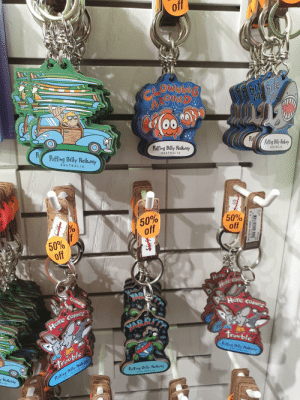 The souvenir keychains for Puffing Billy Railway are beach themed and you will definitely not see a beach or fish on the train: off  hy  ie  Me  CLOWNAG  OEorth  Earih  Pof  Pofing Bly Rahay  Poffing Billy Railway  P  Poffing Billy Railway  AUSTRALIA  AUSTRALIA  AUSTRALIA  50%  off  50%  off  50%  off  Here  Here coie  MARA  COMES  Here cOMe  YABRITY  Here CoMes  trouble  Rfng Bly Racy  w*a*  Trouble  Poffing Billy Raihway  àUSTRALIA  Railway  Poffing Billy Raikvay  AUSTRALIA  ALIA  A  9328421 107292  KR-19  KERING WO RERE COMES TROU The souvenir keychains for Puffing Billy Railway are beach themed and you will definitely not see a beach or fish on the train