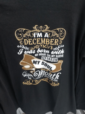 Found at the local thrift store today.: OI'M AC  DECEMBER  wman  I was born iwith  MY HEART ON MY SLEEVE  AFIREIN  MY SOUL  and  CAN'T  R  NTROL Found at the local thrift store today.