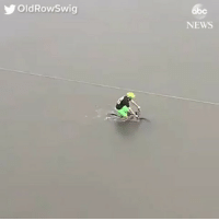 Abc, Memes, and News: OldRowSwig  abc  NEWS rp @abcnews - Video shows man biking through extremely flooded streets of Houston, Texas in the wake of Hurricane Harvey. hurricaneharvey hurricane storm weather severeweather bike Houston Texas flood flooding floodwater @pmwhiphop