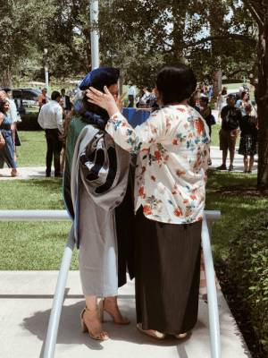 Being Alone, College, and Doctor: OLICE  UNIVESSITY My sister, a first-generation Vietnamese American, graduates from medical school and shares a joyous cry with my mother. No one in my mom's family has ever had the opportunity to go to college, let alone dream of becoming a doctor.