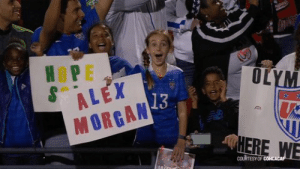 Memes, Yeah, and Alex Morgan: OLYM  ALEX  MORGAN  13  HERE WE  COURTESYOF @USWNT @ADizzle23 @Ashlyn_Harris @AlyssaNaeher @AbbyDahlkemper @tierna_davidson @crysdunn_19 @alikrieger @kelleymohara @beckysauerbrunn @emilysonnett @moeebrian @julieertz @LindseyHoran @roselavelle @ALLIE_LONG @sammymewy @TobinHeath @CarliLloyd @J_Mac1422 @alexmorgan13 Alex scored her 100th goal on April 4th.  Yeah 💯 !!!  You're going to want to tap that follow button. She has a tendency to induce this feeling in fans... https://t.co/z1XfvPbPjc