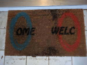 Portal, Mat, and Ome: OME WELC A portal welcome mat!