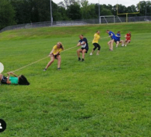 On our last day of band camp we dragged the color guard across the ground in tug of war: On our last day of band camp we dragged the color guard across the ground in tug of war