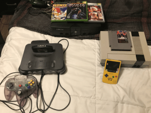 My dad was cleaning out his garage and found all the old consoles we used to play!: ONLY ON  XBOX  XeaX  XOOX  SONIC  LEGA COLLECTION  TINL M  HITE  ID OR A  VI  MATURE 1  M  EVERYONE  TECMOL-  TECMO  Xeox  PUNCH-OUT!!  c  BA  ENTERTAINMENT SYSTEM  THROK 2  BESET  OFF  GAME BOY COLOR  54  Mrtoe  Pakeily  Nintondo My dad was cleaning out his garage and found all the old consoles we used to play!