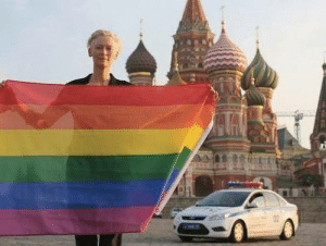 Tumblr, Blog, and Http: oscrz:  worldofmy-own:  Tilda Swinton risked arrest waving a rainbow flag in front of the Kremlin in violation of Russia's new homosexual propaganda bill. And she wants everyone who can to reblog it in solidarity. Guys please reblog this, it won't ruin your blog, this is important