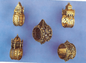 "vladislava:  mylistofthangs:  Antique Jewish wedding rings.   These are absolutely gorgeous. Some info:  Antique Jewish wedding bands are stellar examples of the artistry of jewelry making. The rings are made of a metal circle, molded to fit the would-be owner, topped with an architectural feature resembling a house. The goldsmith would then engrave something on the exterior of the ""house""; engravings were also commonly hidden inside, in which case the ""house"" – or bezel – would slide open. The engraving would usually read Mazal Tov, or the Hebrew initials M.T.  The rings' houses varied in design from castle-like, to square, round or hexagonal. The structures were representations of either the Holy Temple or synagogues in the diaspora. Large in diameter and heavy due to the architectural features, many of the rings are practically unwearable. Morgan ponders the question as well, saying that there is no conclusive evidence, either in Jewish tradition or in the Christian documentation recording Jewish practices, of such rings ever having been worn. Trading in gold, jewels and precious stones was the trade of choice by wealthy Jewish merchants for hundreds of years. The memoir portrait of Gluckel of Hamlen, the daughter of a gold merchant of those times, depicts a wedding ring embroidered in gold thread, hanging from a necklace, which may have been the way the rings were worn after the wedding ceremony.  Jewish wedding bands are unique and although many of them are magnificent and expensive, none have stones set in them. The rings are devoid of their classical focal point due to a rabbinical ordinance barring setting gemstones in wedding bands, or engraving them with hallmarks – the latter first appearing in the 19th century. Also, Jewish goldsmiths were not allowed to join guilds and mark their creations until circa that time. (via)   : OUL vladislava:  mylistofthangs:  Antique Jewish wedding rings.   These are absolutely gorgeous. Some info:  Antique Jewish wedding bands are stellar examples of the artistry of jewelry making. The rings are made of a metal circle, molded to fit the would-be owner, topped with an architectural feature resembling a house. The goldsmith would then engrave something on the exterior of the ""house""; engravings were also commonly hidden inside, in which case the ""house"" – or bezel – would slide open. The engraving would usually read Mazal Tov, or the Hebrew initials M.T.  The rings' houses varied in design from castle-like, to square, round or hexagonal. The structures were representations of either the Holy Temple or synagogues in the diaspora. Large in diameter and heavy due to the architectural features, many of the rings are practically unwearable. Morgan ponders the question as well, saying that there is no conclusive evidence, either in Jewish tradition or in the Christian documentation recording Jewish practices, of such rings ever having been worn. Trading in gold, jewels and precious stones was the trade of choice by wealthy Jewish merchants for hundreds of years. The memoir portrait of Gluckel of Hamlen, the daughter of a gold merchant of those times, depicts a wedding ring embroidered in gold thread, hanging from a necklace, which may have been the way the rings were worn after the wedding ceremony.  Jewish wedding bands are unique and although many of them are magnificent and expensive, none have stones set in them. The rings are devoid of their classical focal point due to a rabbinical ordinance barring setting gemstones in wedding bands, or engraving them with hallmarks – the latter first appearing in the 19th century. Also, Jewish goldsmiths were not allowed to join guilds and mark their creations until circa that time. (via)"