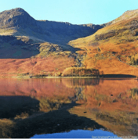 Beautiful, Memes, and Images: Owen Humphreys/Press Association via AP Images BEAUTIFUL: Autumn colors are reflected in Buttermere Lake in Cumbria, United Kingdom.