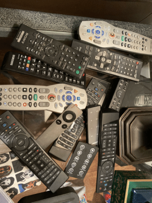 LOOK AT ALL THESE REMOTES.: PAGE  ETTING  OTV  TV INPUT  ZOOM A  PAGE +  PAGE-  GUIDE  ELEC  2#3  Off  SEARCH  AVA  MENU  LAST  PUT  DD  4.  PAGE -  3.  4  GUIDE  PAGE +  FAV  DVR  SELECT  LAST  POWER  HEATER  FLAME  FLAME  SEARCH  INFO  FUEL BED  EXIT  3  TIMER  BACK LIGHT  FAV  NIA  ICABLEVISION  పోట్టి  A50-NO  NOW  SLEEP  SETUP OPEN/CLOSE  did  A SRD  CINEMA  DENH  GROUP  CANCEL  10  SLOW/SEARCH  REC  SKIP  DVR  PAUSE  PLAY  LIVE  STOP  DIRECT NAVIGATOR  PLAY LIST  но  MUTE  TOP  MENU  MENU  LAST  ENTER  FAV  GUIDE  EXIT  INFO  DISPLAY  RETURN  SEL  SUBTITLE  AUDIO ANC  y REPLAY  SOURCE  OPEN/  TV  ČLOSE INPUT  PLAY MODE  ZOOM  TV  ISVI  Pan  SEL  VOL  DVC  9.  6  PRE-CH  EXIT  INFO  2.  PICTURE NAVI  GUIDE  FAV  CLEAR  MUTE  AUDIO SUBTITLE  LAST  CH  TIME/TEXT  CH  LIST  MENU  MUTE  CH  LIVE  SMART  HUB  GUIDE  VOL  RETURN  ON DEMAND  OLS  INFO  LIVE  DISPLAY  DVR  PREV  REPLAY ADVANCE NEXT  REC  PLAY  RETURN  EXIT  FAST/SLOW  PLAY  PAUSE  A B  STOP  2  I3D  HAL SPORTS  CC  SONY  I3D  9.  BN59-01199F  ZOOM  DVD  RMT-D197A R  SAMSUNG  #3  PIP LOOK AT ALL THESE REMOTES.