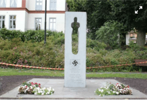 Trashy, Swastika, and Painting: Painting a swastika on the Utøya memorial on it's 8th yearday