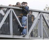 Suicide, Man, and People: People Holding Onto Man Trying To Commit Suicide