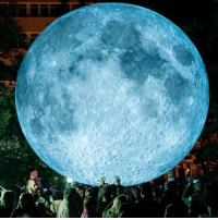 Memes, Moon, and Watch: People watch a light object called The Museum of the Moon created by British artist Luke Jerram and displayed at the Medical Garden in Bratislava, Slovakia, during the White Night festival. PHOTO: JOE KLAMAR - AFP BBCSnapshot art installation museum moon LukeJerram Bratislava Slovakia