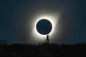 Eclipse, Total, and Solar Eclipse: Perfect Shot of Person 'Holding' the Total Solar Eclipse. (Credit: Albert Dros)
