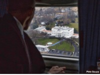 Former President Barack Obama looks at The White House outside the window of a military helicopter while departing Washington, D.C. abcn.ws/2jGOxaa: Pete Souza Former President Barack Obama looks at The White House outside the window of a military helicopter while departing Washington, D.C. abcn.ws/2jGOxaa