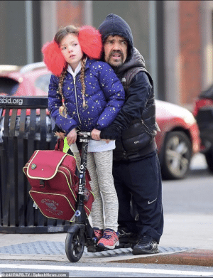 Peter Dinklage and his daughter on a scooter: Peter Dinklage and his daughter on a scooter