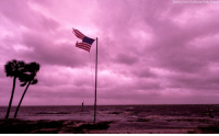 An American flag battered by Hurricane Michael continues to fly in the rose-colored light of sunset at Shell Point Beach on October 10, 2018 in Crawfordville, Florida.: Photo by Mark Wallheiser/Getty Images An American flag battered by Hurricane Michael continues to fly in the rose-colored light of sunset at Shell Point Beach on October 10, 2018 in Crawfordville, Florida.