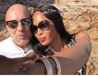 Photo of me and my sugar daddy moments before pushing him off a cliff and using his life insurance to fund my cosmopolitan lifestyle: Photo of me and my sugar daddy moments before pushing him off a cliff and using his life insurance to fund my cosmopolitan lifestyle