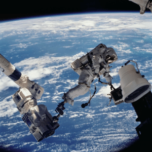 Tumblr, Blog, and Space: photos-of-space:  Astronaut David A. Wolf, STS-112 mission specialist, anchored to a foot restraint on the Space Station Remote Manipulator System, works outside the Space Shuttle on Mission STS-112 which launched on October 7, 2002. [5723 × 5723]