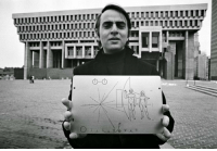photos-of-space:  Carl Sagan holding the Pioneer 10 plaque. Currently flying into interstellar space more than 7.6 billion miles away. [1049 x 720]: photos-of-space:  Carl Sagan holding the Pioneer 10 plaque. Currently flying into interstellar space more than 7.6 billion miles away. [1049 x 720]