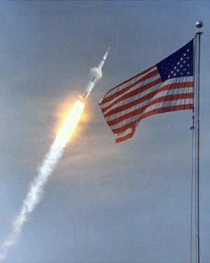 Complex, Tumblr, and American: photos-of-space:  The American flag heralds the flight of Apollo 11, the first Lunar landing mission. The Apollo 11 Saturn V space vehicle lifted off with astronauts Neil A. Armstrong, Michael Collins and Edwin E. Aldrin, Jr., at 9:32 a.m. on July 16, 1969, from Kennedy Space Center's Launch Complex 39A.[2400x3000]