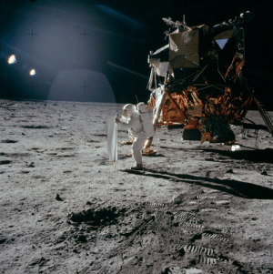 photos-of-space:  This bright sunlight glints  long dark shadows marks of lunar surface is taken by Apollo 11 astronaut Neil Armstrong in July 20, 1968. In the image, the spacesuited lunar module pilot Buzz Aldrin is unfurling a long sheet of foil known as solar wind composition experiment. Credit:NASA.: photos-of-space:  This bright sunlight glints  long dark shadows marks of lunar surface is taken by Apollo 11 astronaut Neil Armstrong in July 20, 1968. In the image, the spacesuited lunar module pilot Buzz Aldrin is unfurling a long sheet of foil known as solar wind composition experiment. Credit:NASA.