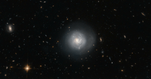 Smooth, It's Spherical!, and Tumblr: pictures-of-space:    A Galaxy at the Center of the Hubble Tuning ForkThis galaxy is known as Mrk 820 and is classified as a lenticular galaxy — type S0 on the Hubble Tuning Fork. The Hubble Tuning Fork is used to classify galaxies according to their morphology. Elliptical galaxies look like smooth blobs in the sky and lie on the handle of the fork. They are arranged along the handle based on how elliptical they are, with the more spherical galaxies furthest from the tines of the fork, and the more egg-shaped ones closest to the end of the handle where it divides. The two prongs of the tuning fork represent types of unbarred and barred spiral galaxies.  For more information visit our webpage here