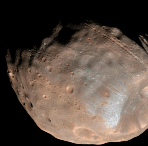 Tidal, Tumblr, and Blog: pictures-of-space:    Mars' Moon Phobos is Slowly Falling ApartNew modeling indicates that the grooves on Mars' moon Phobos could be produced by tidal forces – the mutual gravitational pull of the planet and the moon. Initially, scientists had thought the grooves were created by the massive impact that made Stickney crater (lower right).  For more information visit our webpage here