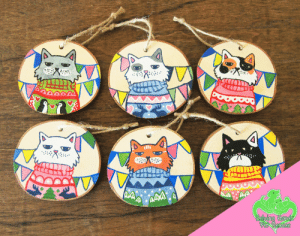 meme-mage:    Set of 6 Handpainted Grumpy Sweater Cats - Wood Slice Ornaments - Supporting Animal Rescue     This is a dog and/or cat related item, which means 40% of profit from the sale of this item will be donated to Helping Hands Pet Rescue!HHPR is a non-profit organisation started by a group of veterinary technicians in 2000, with the support and help of a few veterinarians. HHPR grew from a small rescue operation based out of the animal hospital (initially focusing on ex-racing greyhounds and puppy mill dogs), to one of the largest no-kill rescue shelters in Gainesville! The majority of HHPR's intakes come straight from the Animal Services' euthanasia list within Gainesville and surrounding counties.   : ping Hande  Pet Recaue meme-mage:    Set of 6 Handpainted Grumpy Sweater Cats - Wood Slice Ornaments - Supporting Animal Rescue     This is a dog and/or cat related item, which means 40% of profit from the sale of this item will be donated to Helping Hands Pet Rescue!HHPR is a non-profit organisation started by a group of veterinary technicians in 2000, with the support and help of a few veterinarians. HHPR grew from a small rescue operation based out of the animal hospital (initially focusing on ex-racing greyhounds and puppy mill dogs), to one of the largest no-kill rescue shelters in Gainesville! The majority of HHPR's intakes come straight from the Animal Services' euthanasia list within Gainesville and surrounding counties.