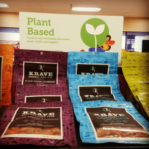 Beef, Fam, and God: Plant  Based  If you're into minimally processed  grain, fruits and veggies!  FAM IT YOURCEL SAV  PigTUAR  KRAVE  icon on shelf tags.  1 C  1 CHOMP  at  NA PINCH  THE TASTE O ors  CUT TO  FLAVURED MEAT  KINDLING  KE TASTE  TAME THAT GROWUNG 5TOMACH  IN A  PINCH  YGRKS  ateald Soo00-Eeereeal  it wo  ESTE  KIN A PINOH  EN BELEK  HAVE  OWN  THE  OUTD DC  THE HOG  STANWARD  PINE  WORKS  KINOLING  CHOMP  SS  IN A PINCH.  JUJ  WEATIED  CHONP  SPICE  1 CHOMP  IN A  PINCH  7WORKS AS  KINDLING  YUM  BPICE  IN A PINCH  t wer sa  NDLING  t Boar  ZODM  le  KRAVE  ON TRE D  TCHOMP  GOBBL LU Schbto Rabbler  CUT TO e AVUREB MEAT  M GOBBLAZ  PIGGY  IN A  PINCH  WELL  SEASONED  HOMP  GOURMET PORK CUTS  IN A PINCH. MEATY IT WORKS AS  KINDLING  worlos as  OVEN ROASTED  NCH  DLEG  THE TASTE  BLACK CHERRY BARBECUE  OBE  ak  GNEP  Prd CHORPE  SEASONED  TE  AITDOOD  CHOMP  GNAW  Kran  K  KRAVE  IN A PINCH.  10  BEEFY  ATNDLITRe  N4 SINSI9  EEFY  KRAVE MP  HERE  THE TASTE  -Feeese!  Cat Dark  RAVE  TRA  AP EER.  PINCH  EATIE  MMOLING  FEM  ke A Hike  A  SMP  GOBBL  Bobble iobblel  EiNAW!  Pig&ut! T RUAR  CUT OOUD  THE THa T  TDOC e RAVE  IN A PINCH  INDLTNG  OBBLE  THE 09De  HER  CROPP  KRA VE  |1 Boar  ZOOM  GOD R M ET P oRK CUTTS  OVEN ROASTED  OUT RRIT TU REN Y OB TS  LEN O N O ARE  BLAC K CH ERRYY BAR BECU E  RPINCH  KINDZING  SEASONED  ke A Hike  MO  ALL-NATURAL  GF  MS  M  De  ALL-NATURAL  TURKEY RAISED WIHOUT ADDED HORMONES  FEDERAL REGULATIONS PROMIOIT TME USE OF HORMORES SN TORKEY  PORK RAISED WITHOUT A  FUDERAL REGULATIONS PROHImIT THE D H ORM ONES  DKIND  URE T  5E  G  ART ALNGEGIENTS MINIMALITY PROCESSED  NET WT 2.7 OZ (76G)  WELL  ore ma  NET WT 2 7 07 (78  oOM  NO ARTIFICAAL NGREDIEMTS MINIMALLY PROCESSED  K Porle  SPICE  as A RA K  GY  EVIVAL KIT  BIRD  ho:s  WRD  SRWT OUR STUFF  Cobible Gob  STRUT YOUR  CHOMP  TURKE  TURK  URKEY  CHOMP  CHO  LLE  PORK  for mea  MIN  GNAW  SNOUTL  SROUT FLAIR  ONT  EN  eter Bech  Life is  MOre macho ON trainis Plant based