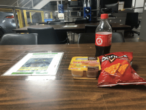 Friends, Oscar Mayer, and Protein: PLEA  ave  ORIG  SHARE A  Coke  WITH  A B  TIDE  2018-01397  HAM  CHEDDAR  WITH CRACKERS  ACHO  CHEES  OSCAR MAYER ean Harm  LAV  Lunchables  LUNCH COMBINATIONS  13g  e.cl  heai  Protein  PER  PACKAGE  FLAVOR  ADDED-  HEDUA URIZED MOKED ERS  260  CALO  CHEESE PRODUCT  720  NET WT 3.2 0Z (90g)  KEP REFAIERATED-DO ROT FRA  STANDARD  CALORIES  PER PKG  A CHIPS  See on nformation for Total Fat Content  WT. 13% 02 (49.6 g)  RIMS  AMA  UNLOCK FAN4 EXPERIEN  AND SCAN HERE  OPEN COKE CON ON SHOUT Eating lunch with all my friends!